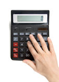 Calculator. Girl's hand calculates, islotaed on white Royalty Free Stock Image