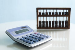 Calculator and abacus Royalty Free Stock Photo