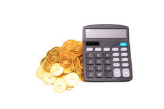 Calculator above coins. With selective focus and available light stock image