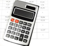 Calculator and account. Calculator close-up isolated on the account Royalty Free Stock Image