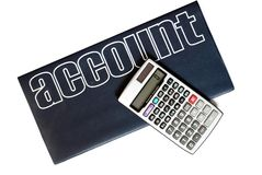Calculator and account book isolated Stock Photos