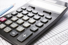 Calculator on Account sheet Royalty Free Stock Photos