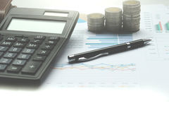 Calculator And Coins Of Thailand On The Office Desk Investment A Royalty Free Stock Photos