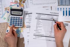 Calculator annual home budget and thinking about his cost. stock photography