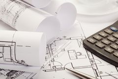Calculator on architecture blueprints Royalty Free Stock Photography