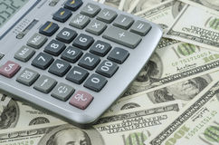 Calculator on a background of american dollar bill Stock Photography