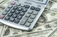 Calculator on a background of american dollar bills. Stock Images