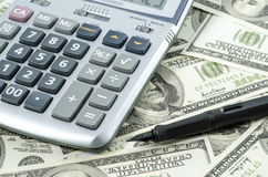 Calculator on a background of american dollar bills. Royalty Free Stock Photography