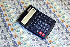 Calculator on background of hundred dollar bills Stock Photography