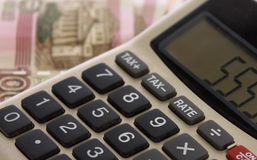 Calculator. On the background of money Stock Photography