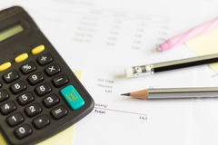 A calculator is on a balance sheet numbers are statistics. photo Stock Photography