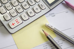 A calculator is on a balance sheet numbers are statistics. photo Royalty Free Stock Image