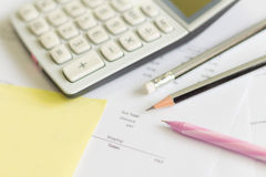 A calculator is on a balance sheet numbers are statistics. photo Royalty Free Stock Photos