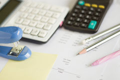 A calculator is on a balance sheet numbers are statistics. photo Royalty Free Stock Images
