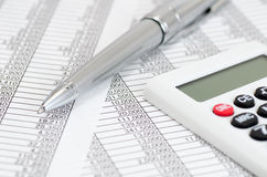Calculator and ballpoint and Accounting documents Stock Photos