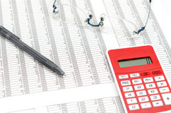Calculator and ballpoint and glasses and Accounting documents Royalty Free Stock Image
