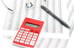 Calculator and ballpoint and glasses and Accounting documents Stock Photos