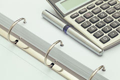 Calculator and ballpoint pen on notebook. accounting concept Stock Photography