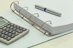 Calculator and ballpoint pen on notebook. accounting concept Royalty Free Stock Images