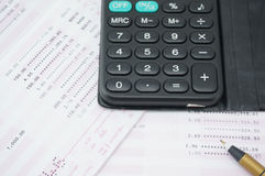 Calculator on bank account. Calculator put on the pink and white bank account. For calculating the interest rate Royalty Free Stock Photography
