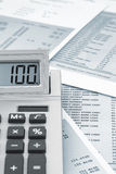 Calculator on a bank statement Royalty Free Stock Photos