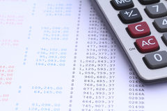 Calculator on bank statement Royalty Free Stock Image