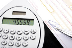 Calculator, bank transfer and ball pen Stock Image
