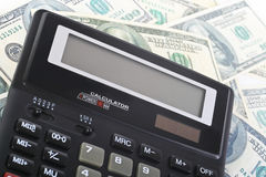 Calculator on banknotes Royalty Free Stock Images
