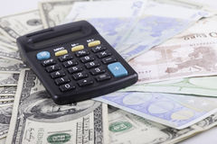 Calculator and banknotes of dollars background Stock Image