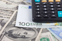 Calculator and banknotes of dollars, euro background Stock Photo