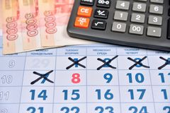 Calculator and banknotes of five thousand rubles are on the cale Royalty Free Stock Image