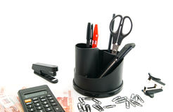 Calculator, banknotes and other office stationery Stock Photos