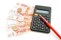 Calculator, banknotes and pen Stock Photos