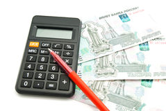 Calculator, banknotes and red pen Royalty Free Stock Images