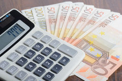 Calculator and banknotes on the table Royalty Free Stock Photo