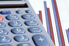 Calculator and bar chart Royalty Free Stock Photography