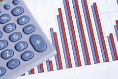 Calculator and bar chart Stock Image