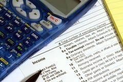 Calculator, belastingsvorm, potlood en stootkussen Stock Afbeeldingen