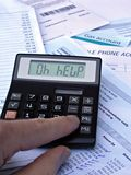 Calculator & bills Stock Photo