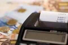 Calculator and bills Stock Photography