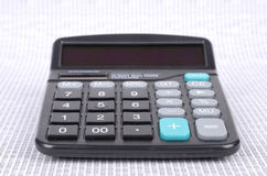 Calculator and binary code Stock Photos