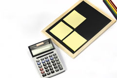 Calculator and black board on white background. Office tools isolated on white background Royalty Free Stock Images