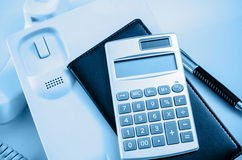 Calculator and black book Stock Image