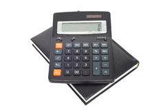 Calculator with black notepad Stock Photography