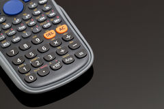 Calculator. A Calculator on a Black Surface, Selective Focus, Focus on Foreground Royalty Free Stock Photography