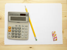 Calculator, blank paper, pencil and eraser Stock Image
