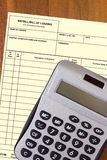 Calculator with a blank waybill Stock Image
