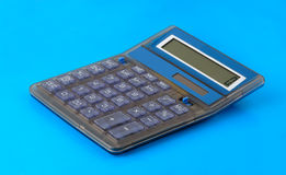 Calculator, on blue background. Royalty Free Stock Images