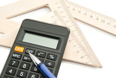Calculator, blue pen and ruler Royalty Free Stock Photo