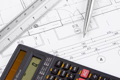 Calculator on a blueprint stock photo